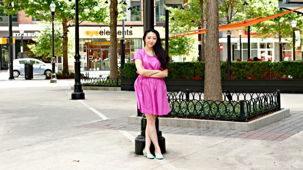 Jennifer Pink Outfit Wide Shot Street Pole Arms Crossed EDITED