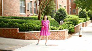 Jennifer Pink Outfit Glittery Fuschia Clutch Purse Brick Wall Full Shot EDITED